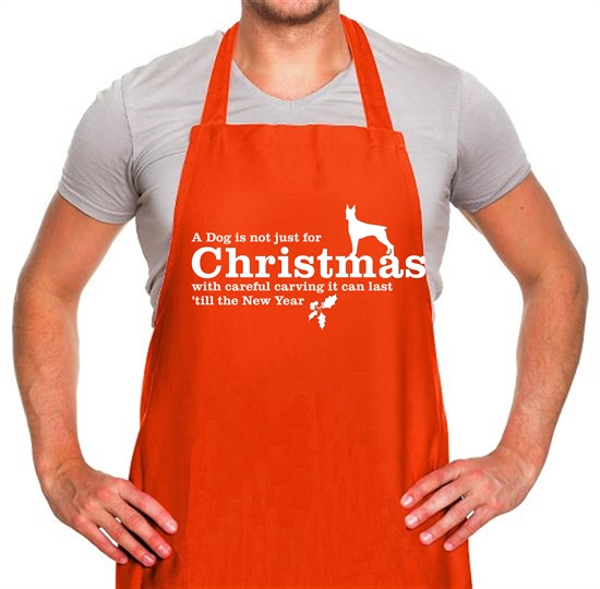 A dog is not just for christmas, with careful carving it can last 'till the new year Apron